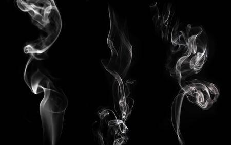 Three kinds of white smoke on a black background. Stok Fotoğraf