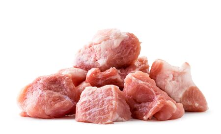 Pile of piece of raw pork meat closeup on a white background. Isolated Banco de Imagens