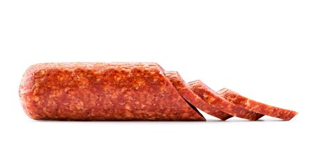 Stick of sausage cut into chunks close up on a white background. Isolated