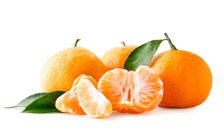 Ripe tangerines with leaves and peeled on a white, isolated. Banco de Imagens