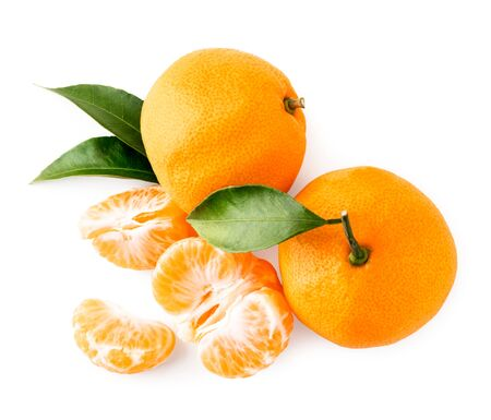 Two ripe tangerines with leaves and peeled slices on a white. The view of the top.