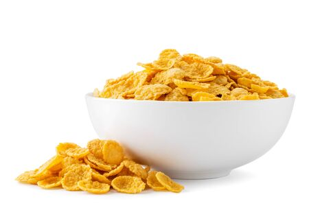 Cornflakes in a plate and scattered on a white. Isolated Banco de Imagens
