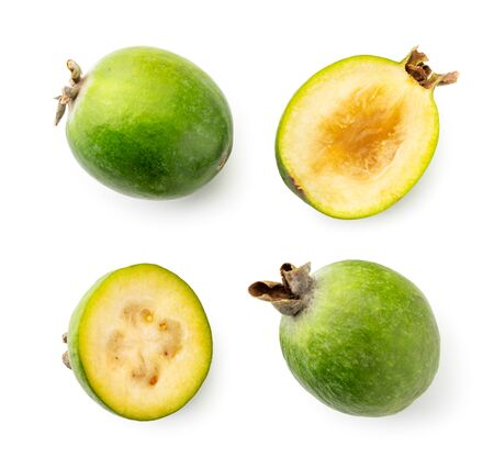 Set of green feijoa and two halves on a white. The view of the top.