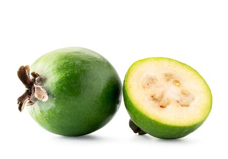 Ripe feijoa and half closeup on a white background. Isolated. Banco de Imagens