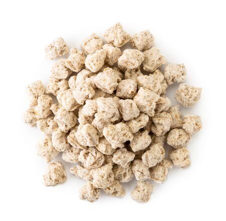 Pile of oat bran for fitness foods on a white background. Banco de Imagens