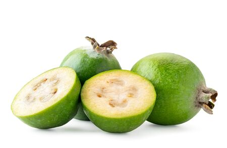 Ripe feijoa and two halves close up on a white background. Isolated. Banco de Imagens