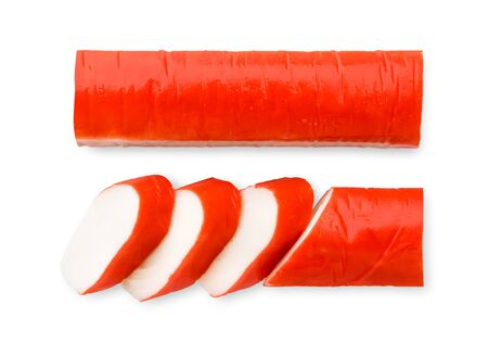 Crab stick cut into pieces and whole on a white background. The view of the top.