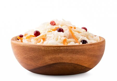 Sauerkraut with carrots and cranberries in a wooden plate on a white background, isolated. Banco de Imagens