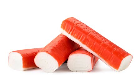 Pile of crab sticks close-up on a white background. Isolated.