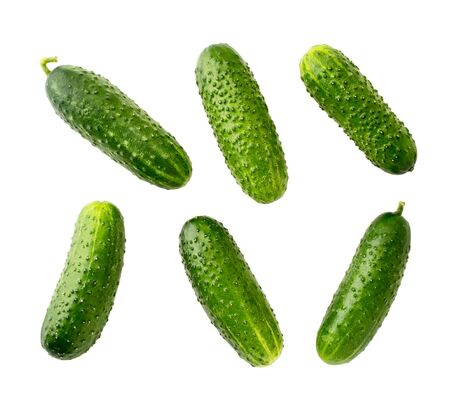 Set of ripe cucumbers carved on a white background.