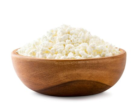 Fresh cottage cheese in a wooden plate close-up on a white background. Isolated