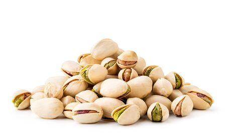 Pile of pistachios in the peel close-up on a white background. Isolated. Stok Fotoğraf