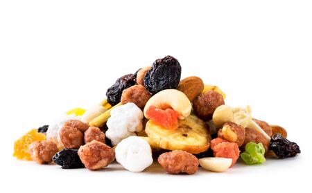 Mix a pile of dried fruits with nuts on a white. Isolated