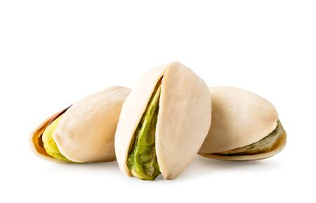 Three pistachios close up on a white. Isolated Stok Fotoğraf
