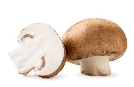 Fresh mushrooms and half closeup on a white. Isolated