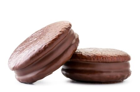 Two cookies in chocolate choco pie closeup on a white. Isolated