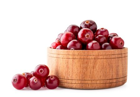 Ripe cranberries in a wooden plate on a white background. Isolated