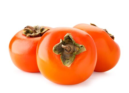Three ripe persimmons on a white background. Isolated Stok Fotoğraf