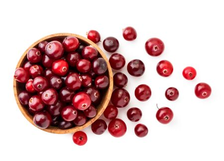 Cranberries in a wooden plate and scattered on a white background. The view of top. Stok Fotoğraf