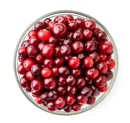 Ripe cranberries in a plate on a white. The view of the top.