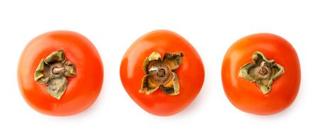 Three ripe persimmons on a white background. The view of top. Stok Fotoğraf
