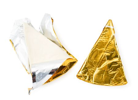 Cheese triangle in foil and opened on a white. The view of the top.