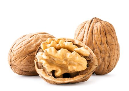 Walnuts and ruined half on a white background. Isolated