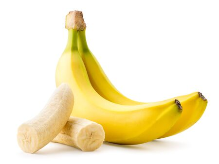 Ripe bananas and peeled flesh close-up on a white. Isolated