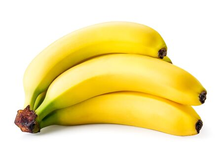 Ripe bananas lie on a white. Isolated