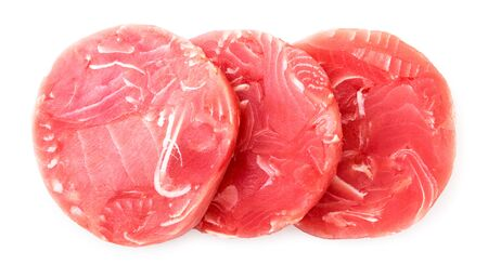 Raw fish medallions on a white background.