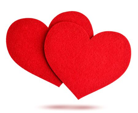 Two red felt hearts fly on a white background, isolated. Valentines day Standard-Bild