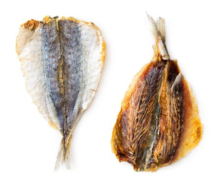 Dried yellow striped fish, selar close-up on a white background. Isolated, top view 스톡 콘텐츠