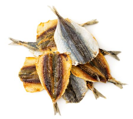Dried yellow striped fish, selar group close-up on a white background, top view.. Isolated, snack to beer