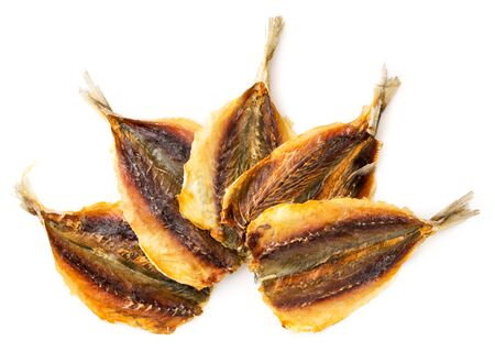 Dried yellow striped fish, group close-up on a white background. Isolated, beer appetizer, top view