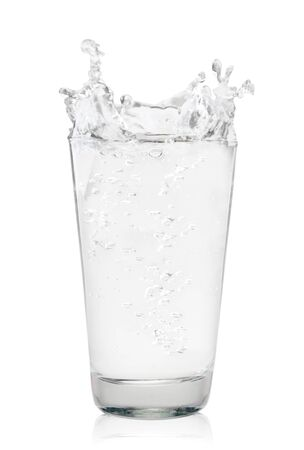 Glass of water with splash close-up on a white background. Isolated