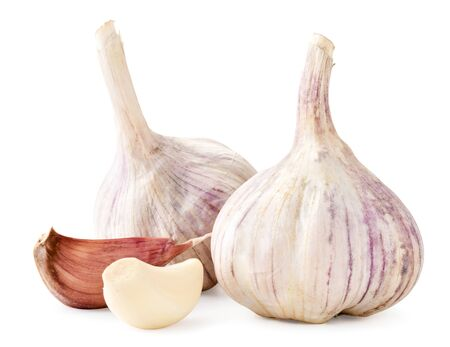 Heads of garlic unpeeled and peeled a clove closeup on a white background. Isolated