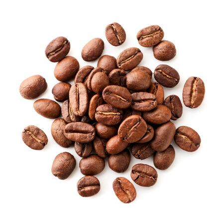 Coffee beans close-up on a white background. Isolated, top view.