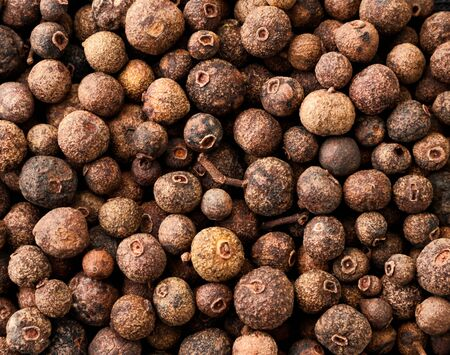 Dried allspice background. The view from top