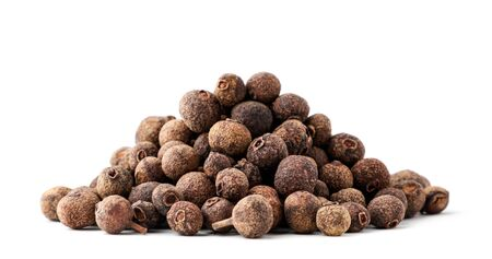 A pile of dried allspice close-up on a white background. Isolated