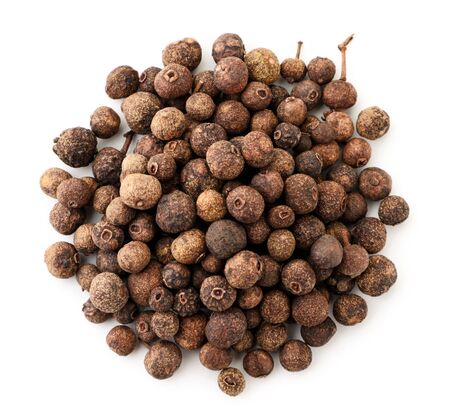 A pile of dried allspice on a white background. The view from top 스톡 콘텐츠