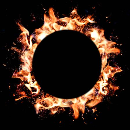 Flames of fire round frame on dark background. Copy space, space for text