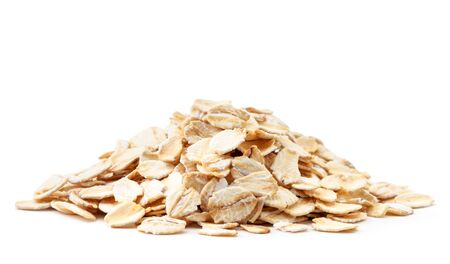 A pile of oatmeal closeup on a white background. Isolated Stockfoto