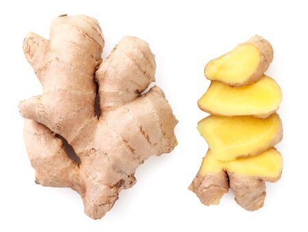 Whole and sliced ginger root close-up on a white background. The view from top