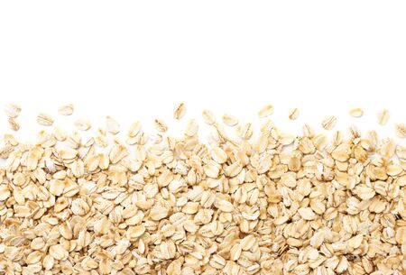 Oatmeal background on a white background, top view. Place for text