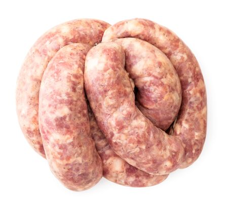 Raw meat sausages on a white isolated background. The view from top