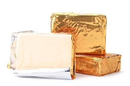 Rectangular melted cheese in packing and without on a white background. Isolated