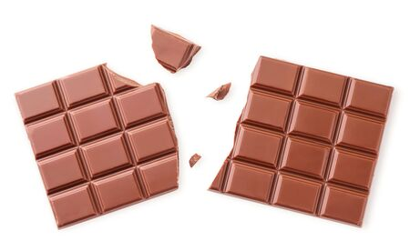 Chocolate bar broken in half closeup on a white background isolated. The view from top