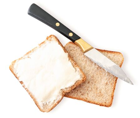 Sandwich with cream cheese and knife close-up on a white isolated background. The view from top 스톡 콘텐츠