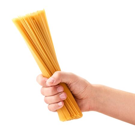 Spaghetti pasta in hand on a white background. Isolated