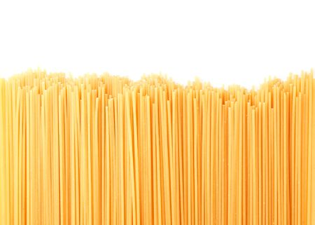 Spaghetti pasta on a white background isolated. The view from top, copy space